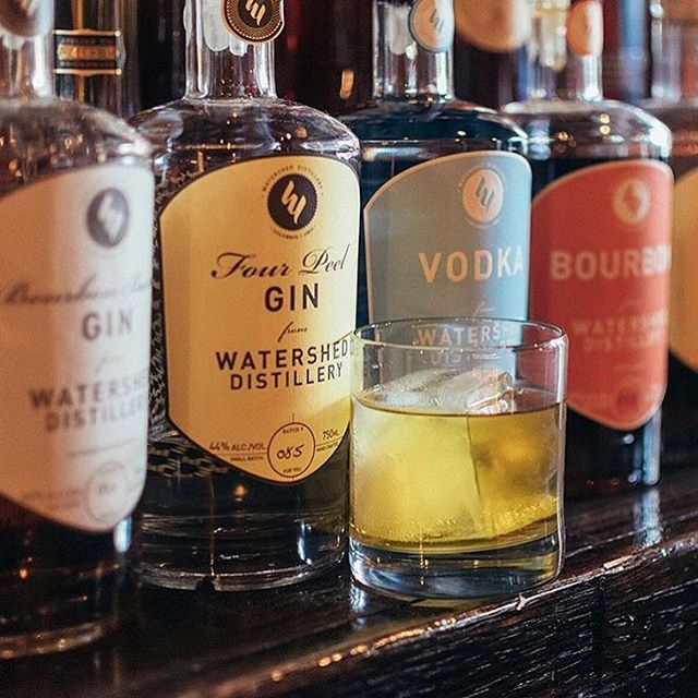 Watershed Distillery gin, vodka and bourbon bottle with custom spirit labels