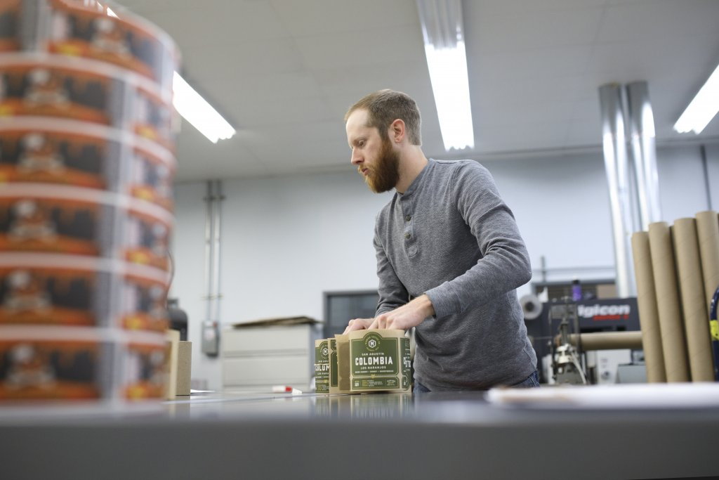 A food product label with health claims being handled by a label printing expert.