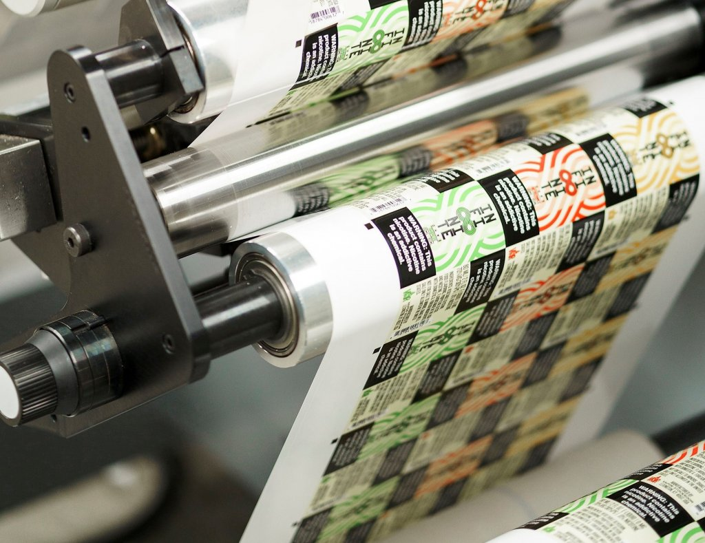 A digital printing machine making 7-color process labels.
