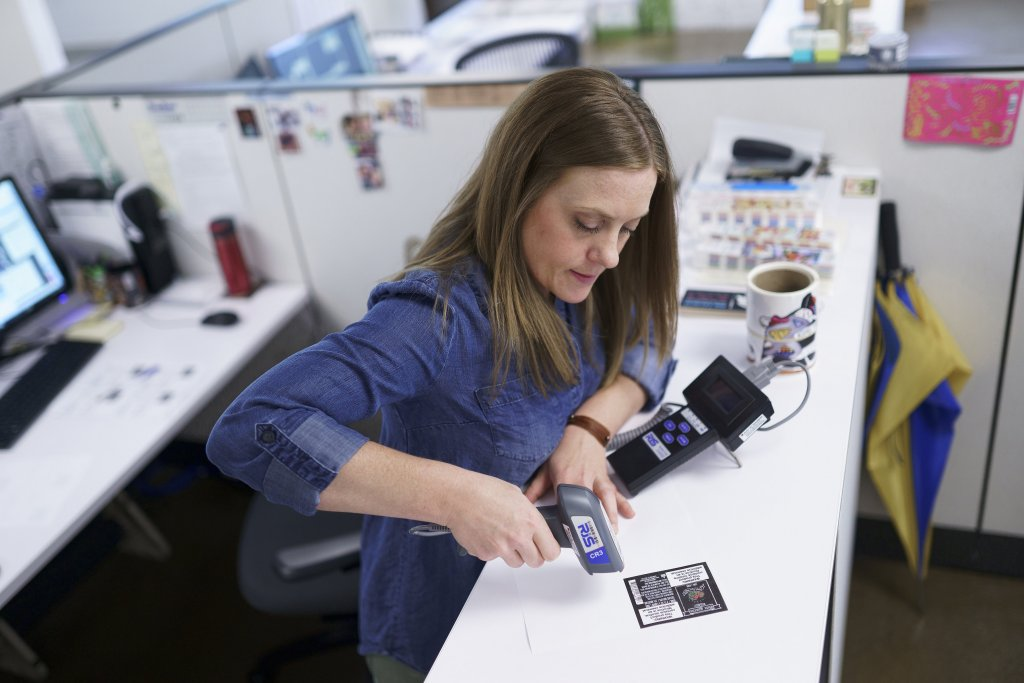 A label printing expert testing a barcode label.