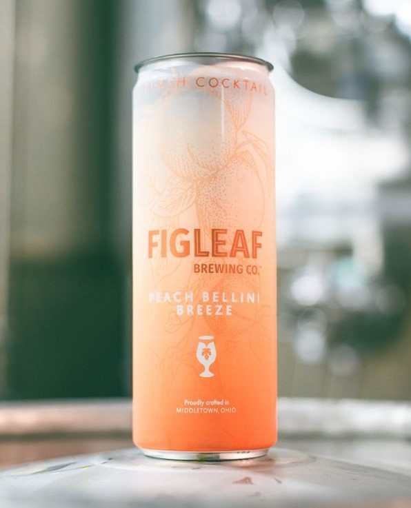 A peach bellini breeze from Figleaf Brewing Co with attractive RTD can packaging.